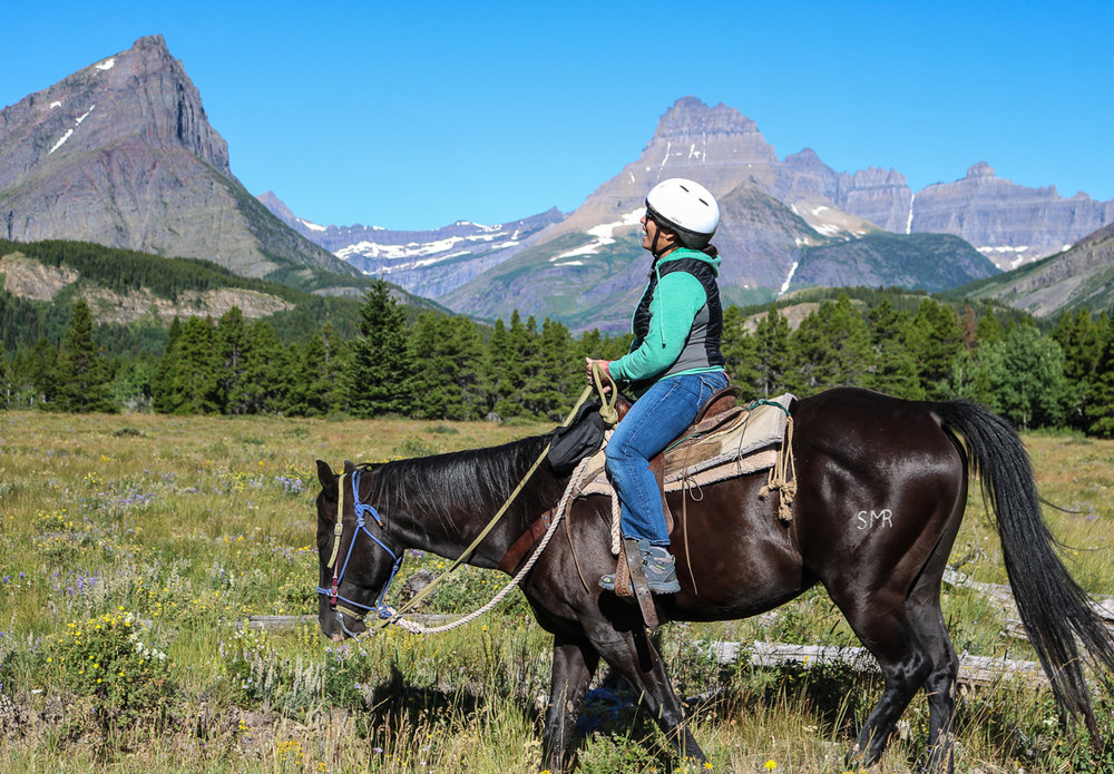 happiness on a horse in Many Glacier.jpg