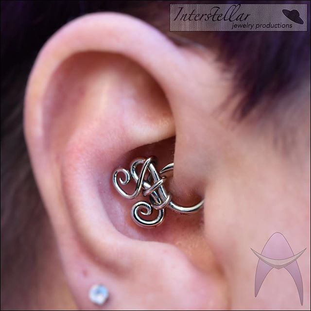 Here's a sweet lil daith with a crazy cool wrapped piece from @interstellarjewelryproductions 🛸 We still have lots of fun swirly bits for both healed and fresh piercings available! Come and see which one calls to you! 👽🖖🏻 #piercing #piercings #earpiercing #earpiercings #daith #daithpiercing #daithpiercings #daithjewelry #daithring #bentpaperclip #interstellarjewelryproductions #uniquepiercing #uniquepiercings #uniquejewelry #customjewelry #curatedpiercings #marinadelrey #aestheticambition