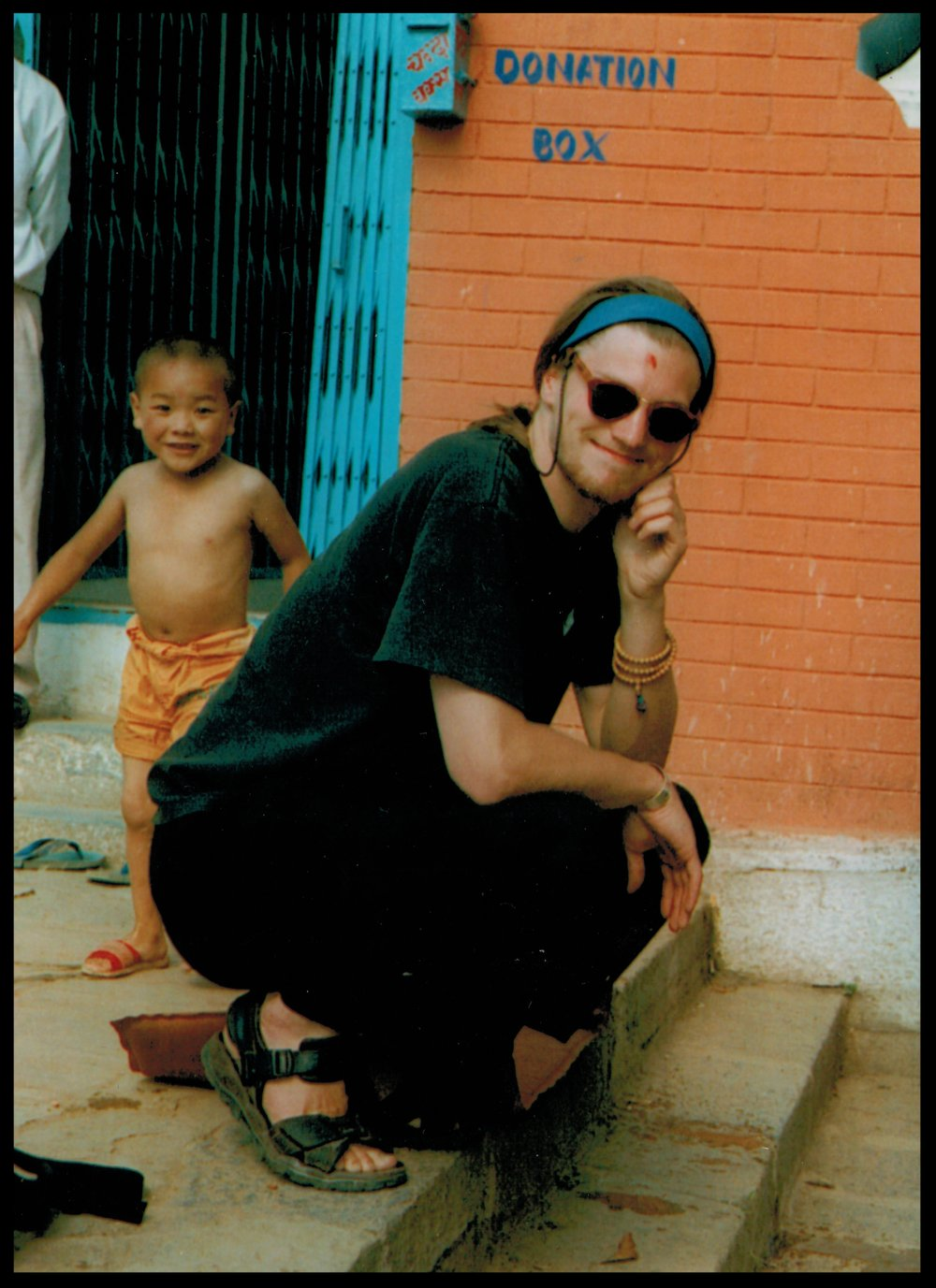 This is me falling in love with Kathmandu. And that's a cheeky young  Cherok Lama  in the background (circa 1997).