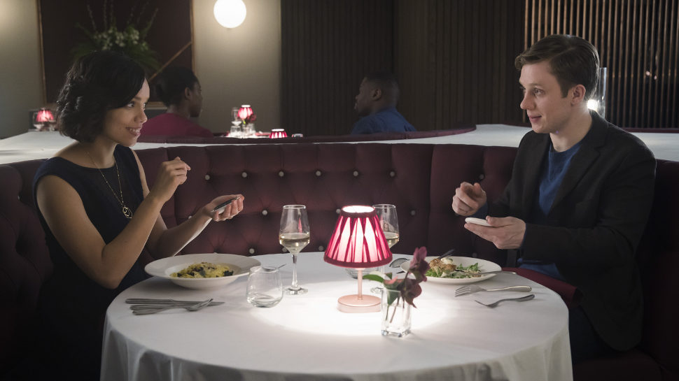 A couple is set up on a date by their electronic Coach. -