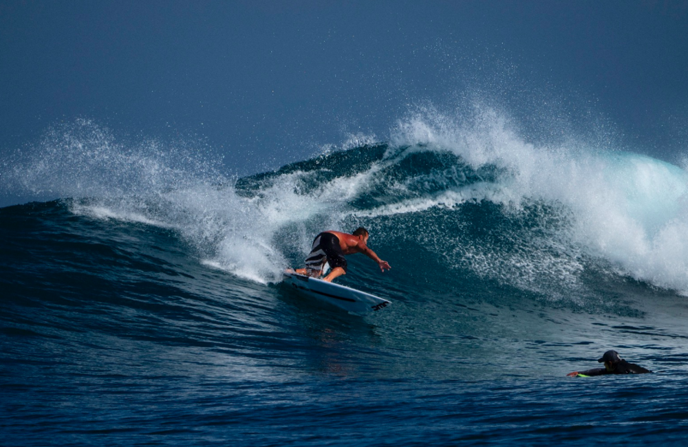 Surf Coach Justin West cutting shapes on one of Madagascar Surf Resort's empty breaks