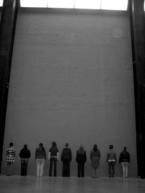 Santiago Sierra, Remake of 'Group of persons facing the wall and person facing into a corner'. 2008.. Tate Modern, Turbine Hall, London UK. Courtesy of the artist.