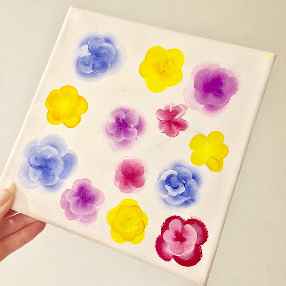 Flower paint canvas holding