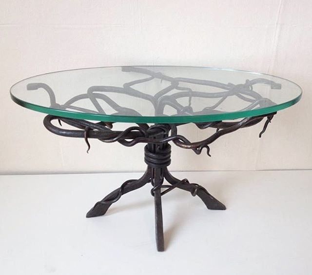 Bit of a throwback! Here is my small scale project from my LV3 first year @plumpton.hammers  And the year I won the young craftsmen of the year award at the south of England show!  I Really enjoyed making this little table, and would love to make something similar again.  #table #glass #forging #blacksmith #vines #bedsidetable #homestyle #tablelegs #customtable #winner #2013 #southofenglandshow #youngcraftsmanoftheyear #youngcraftsman #metalwork #glasstable #metaltable #throwback #wrapped #upset #taper #fire #fireweld #coffeetable #movement #craft #blacksmithing #commisons #available