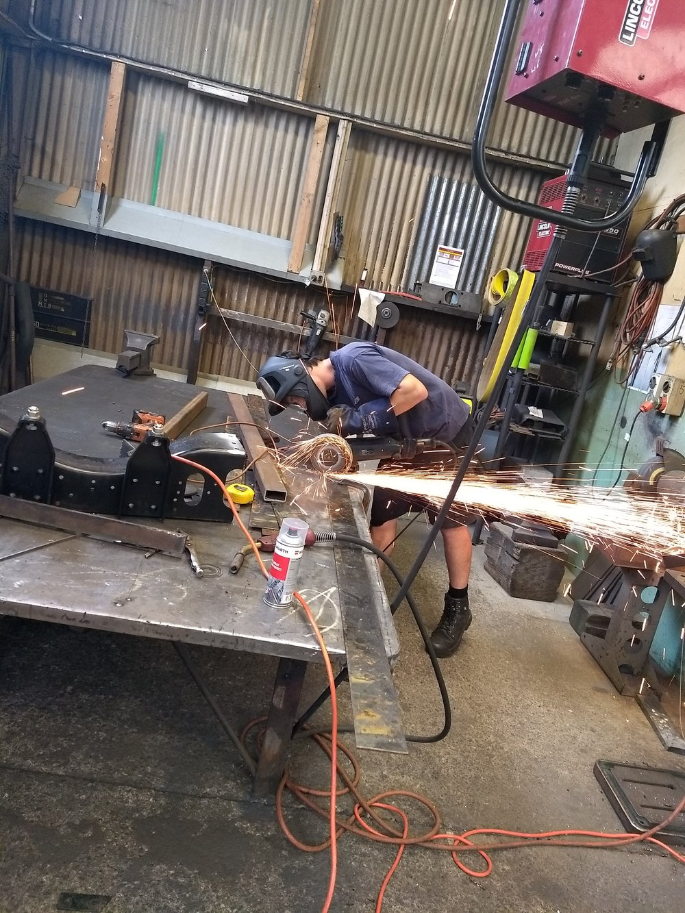 Steel wizard Sean works his magic on a set of steel plate reinforcements for our lofts.