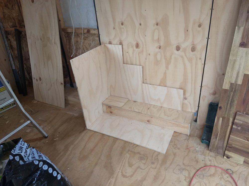 Storage stairs under construction.