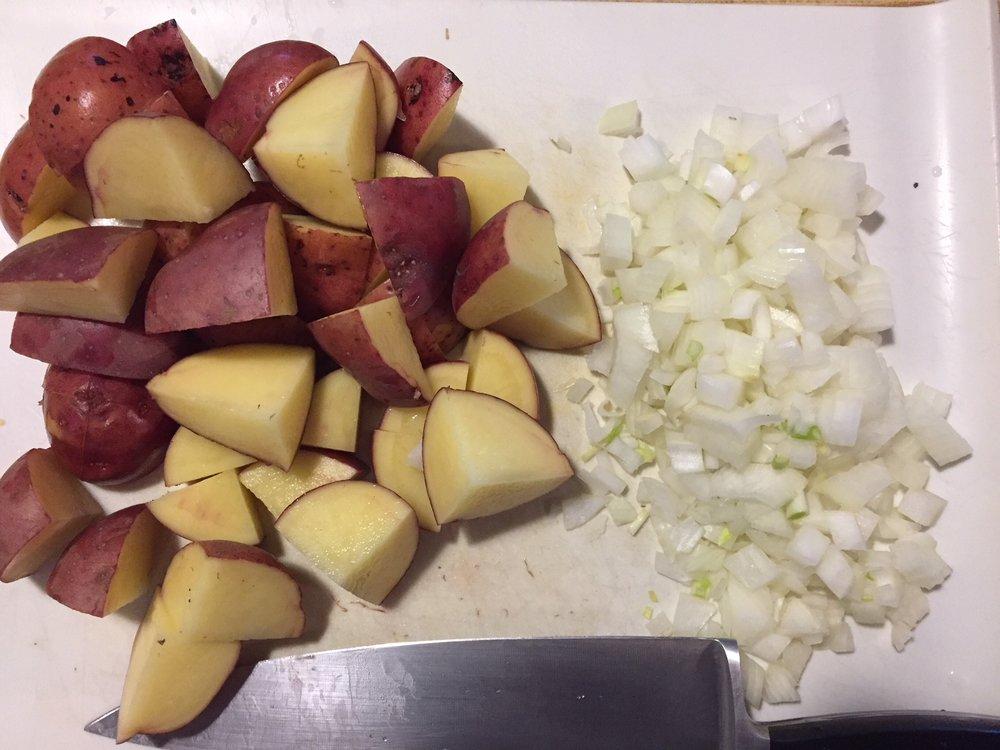 Quarter the potatoes. Dice the onion.