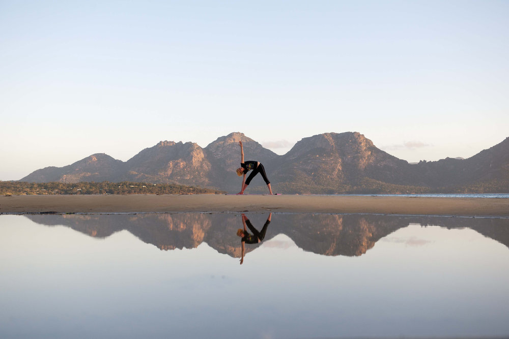 saffire-freycinet_yoga-on-muirs-beach.jpg