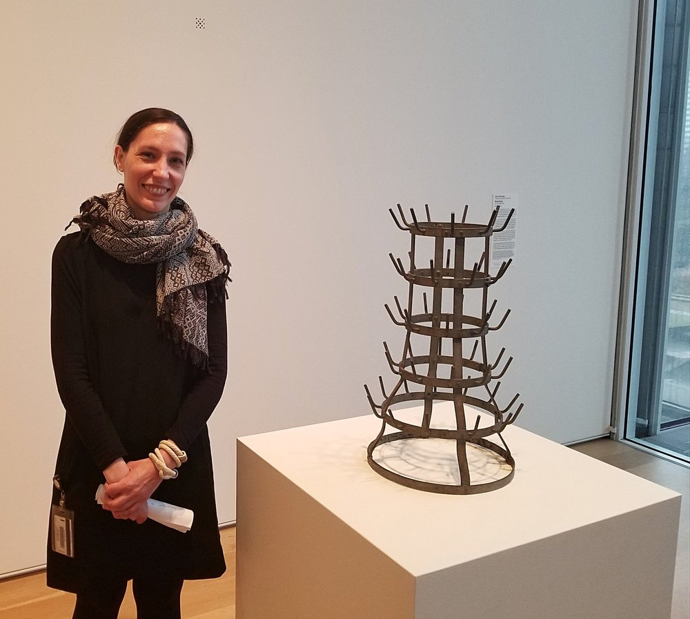 "Katja Dominique Rivera, research associate in the department of modern and contemporary art at the Art Institute of Chicago, next to Duchamp's ""Bottle Rack"""