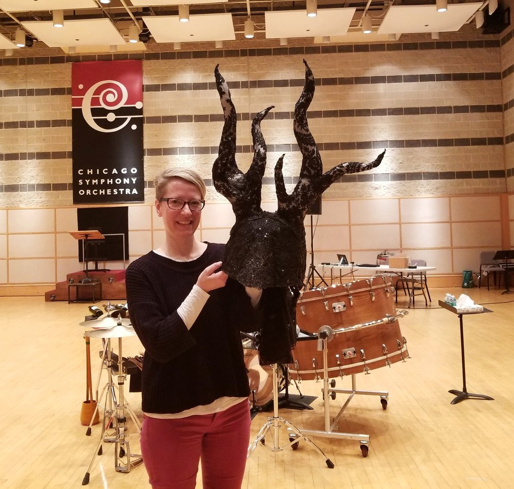 Kirsten holding the specially designed stag mask that flutist Tim Munro will wear on stage