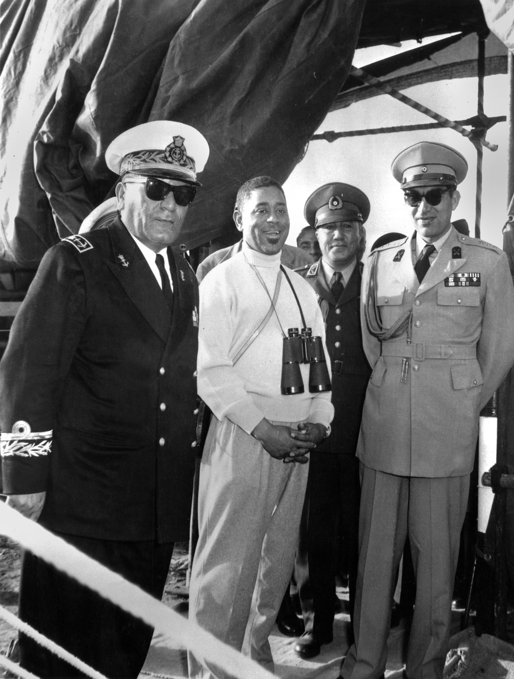 Dizzy Gillespie poses with the Shah of Iran, Mohammad Reza Pahlavi (right), in Iran, 1956. Credit: Malcolm Poindexter III / Courtesy of the Institute of Jazz Studies, Rutgers University