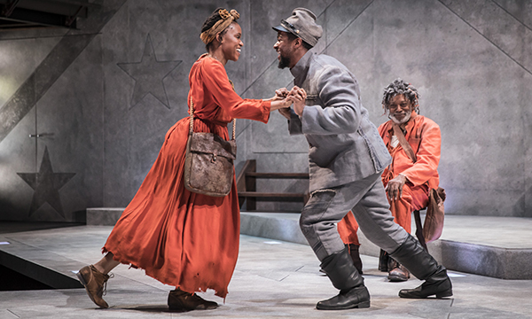 "Aimé Donna Kelly (Penny), Kamal Angelo Bolden (Hero/Ulysses) and Ernest Perry Jr. (The Oldest Old Man) in ""Father Comes Home from the Wars (Parts 1, 2 & 3)"". Image courtesy of Goodman Theatre."