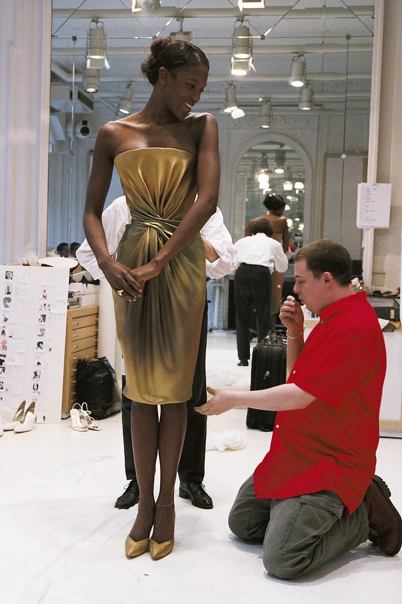 Alexander McQueen pinning one of his dresses early in his career