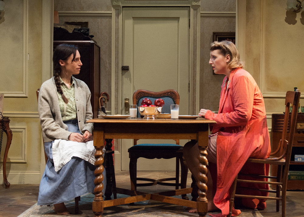 Left to right, Emily Berman and Bri Sudia as two sisters trying to reconnect after years of separation brought on by the rise of the Nazis in Timeline Theatre's production of A SHAYNA MAIDEL.
