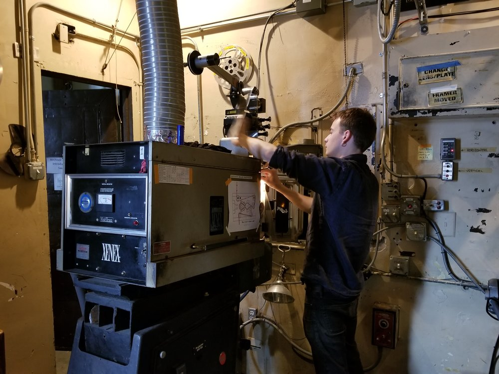 The Music Box Theatre's Julian Antos threading a 70mm film into a projector