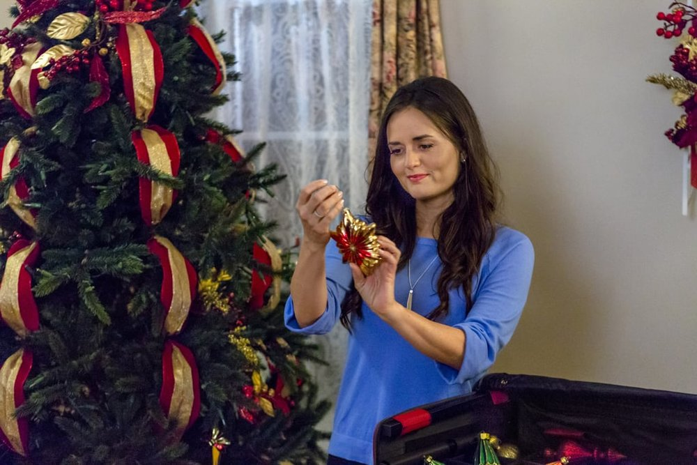 Danica McKellar doing Christmas things in a Hallmark movie