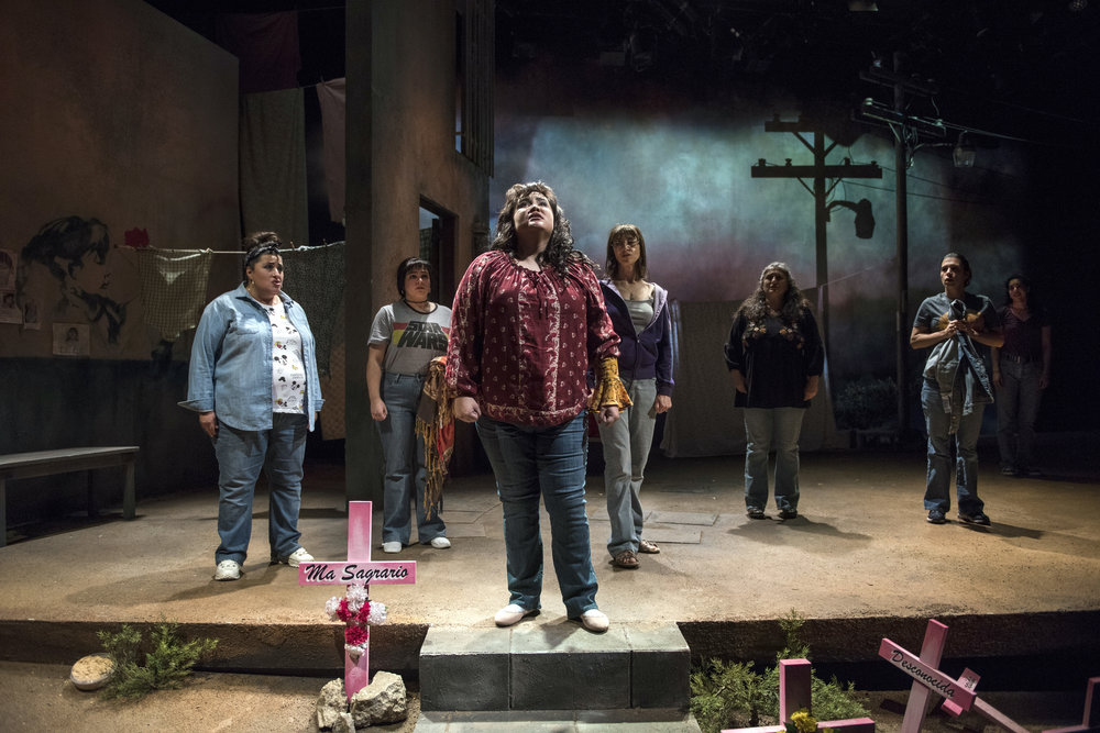 Pictured (Front) ensemble member Karen Rodriguez (Ivonne) and (Rear) cast of La Ruta in Steppenwolf's world premiere production of LA RUTA. Photo by Michael Brosilow.
