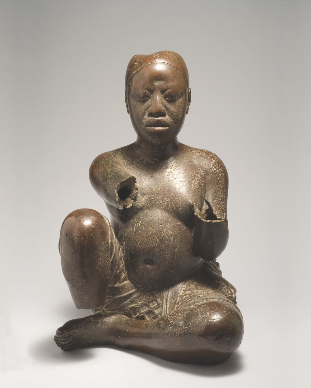 Seated Figure, Possibly Ife, Tada Nigeria, Late 13th-14th century, Copper with traces of arsenic, lead, and tin, H. 54 cm, Nigerian National Commission for Museums and Monuments, 79.R18, Image courtesy of National Commission for Museums and Monuments, Abuja, Nigeria.