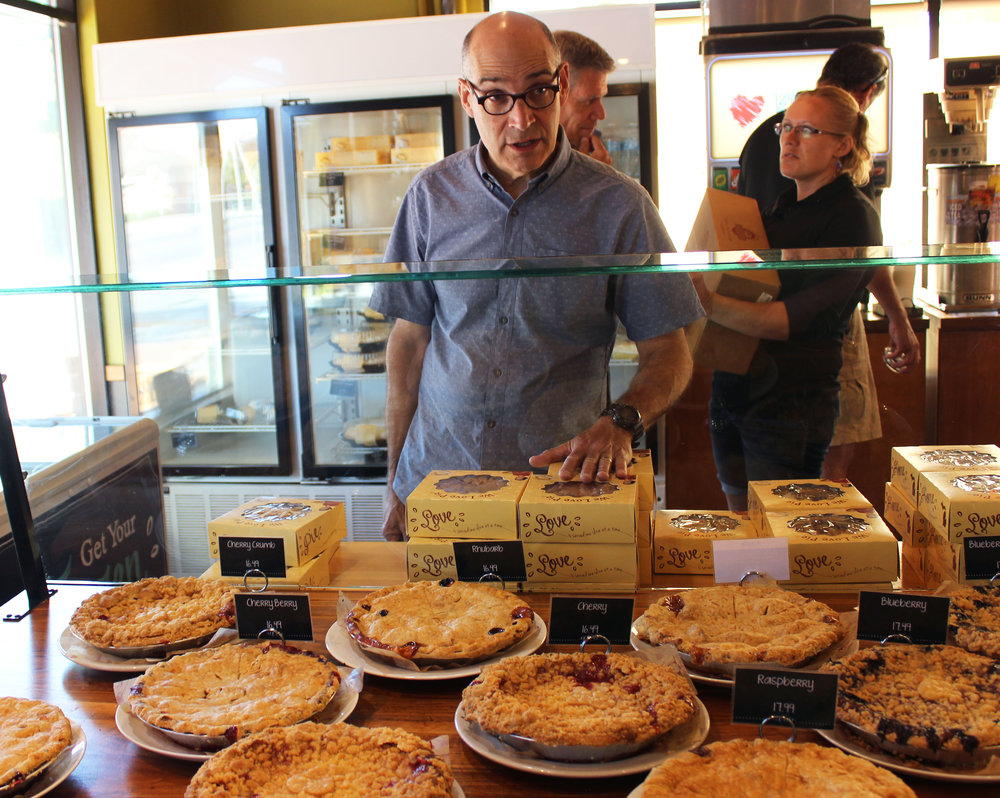 WTTW's Geoffrey Baer checking out some cherry pies in Traverse City