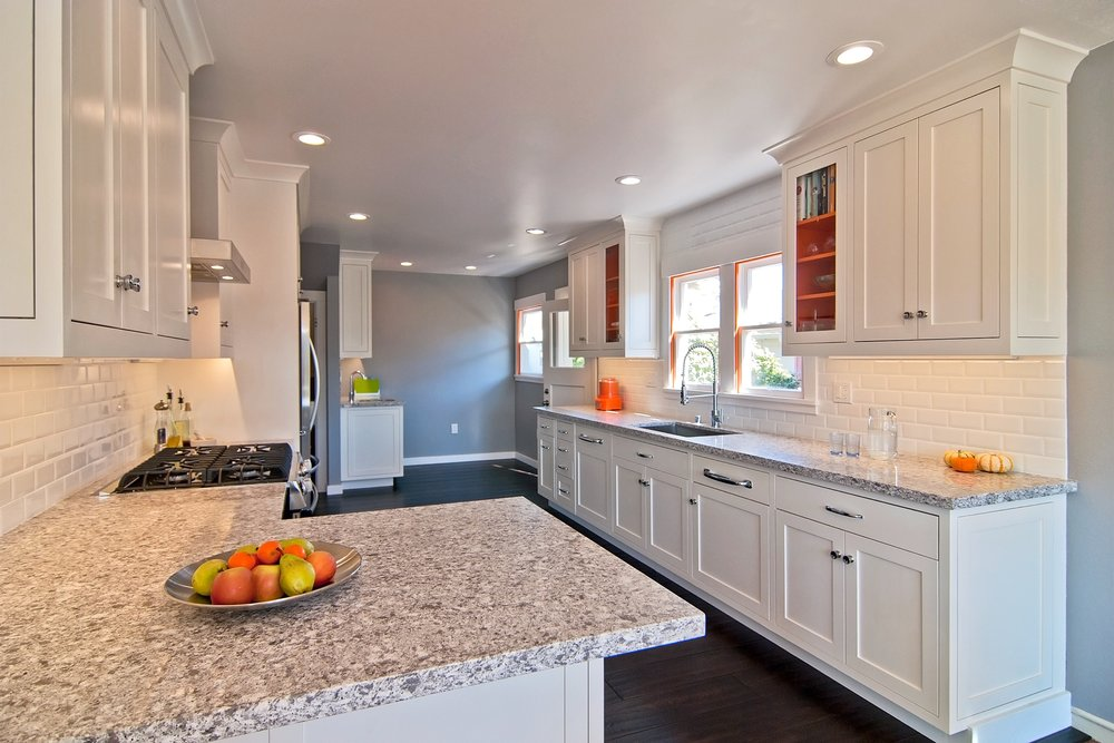 william-adams-design-krusi-park-kitchen-wide-angle-granite-countertops-white-cabinetry.jpg