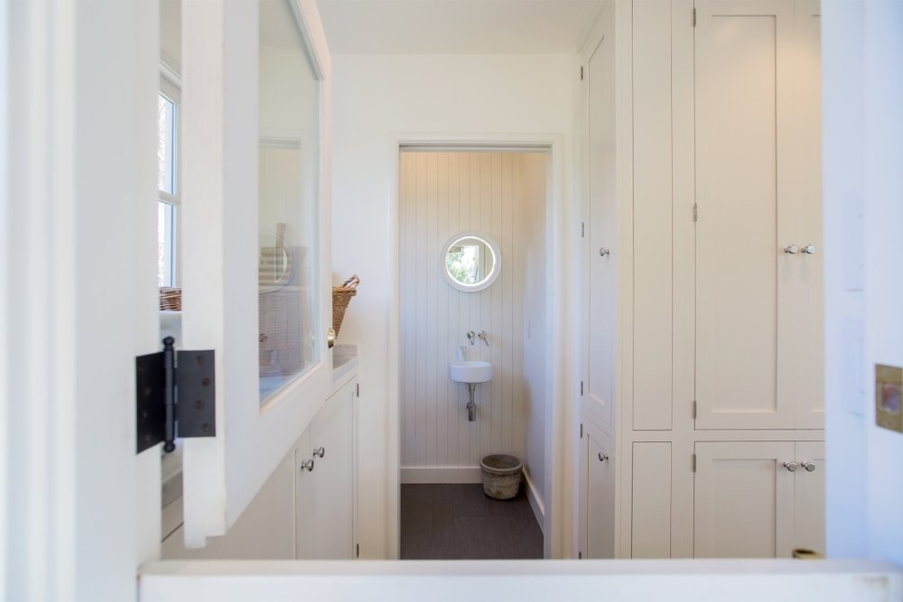 william-adams-design-interior-design-and-architecture-home-remodeling-san-francisco-california-leona-heights-dutch-door-laundry-room-view-to-bathroom.jpg