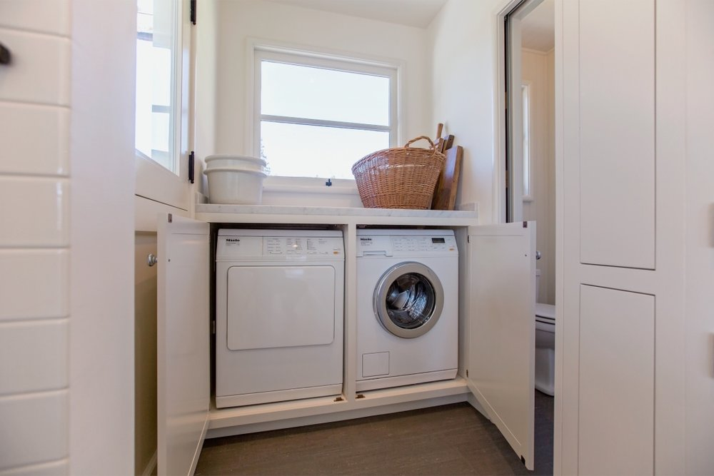 william-adams-design-interior-design-and-architecture-home-remodeling-san-francisco-california-leona-heights-laundry-area-miele-washer-and-dryer.jpg