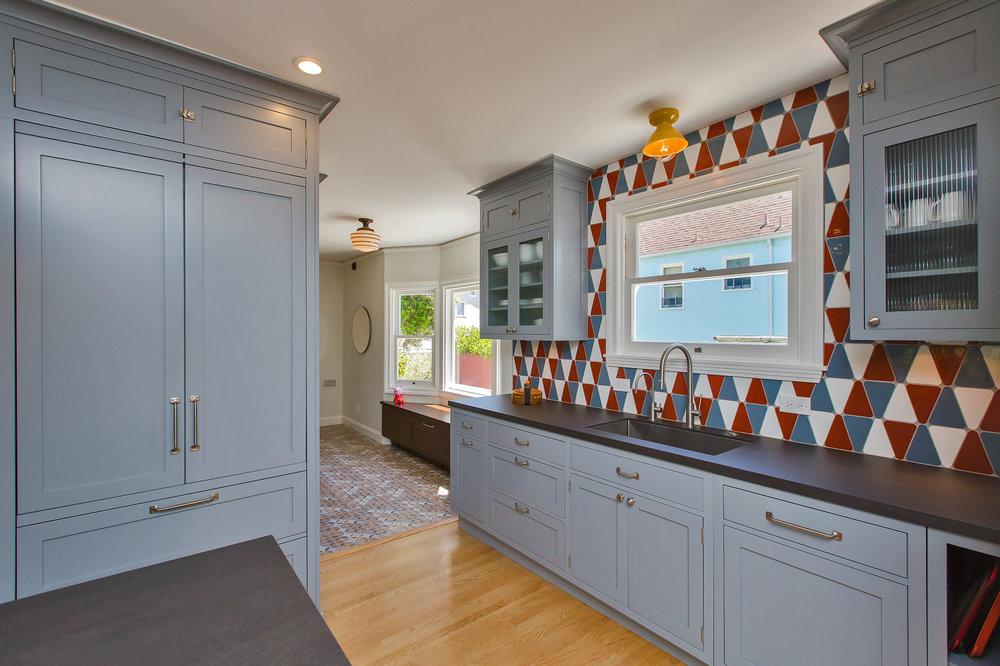 william-adams-design-colorful-tudor-kitchen-cabinetry-sink-countertops.jpg