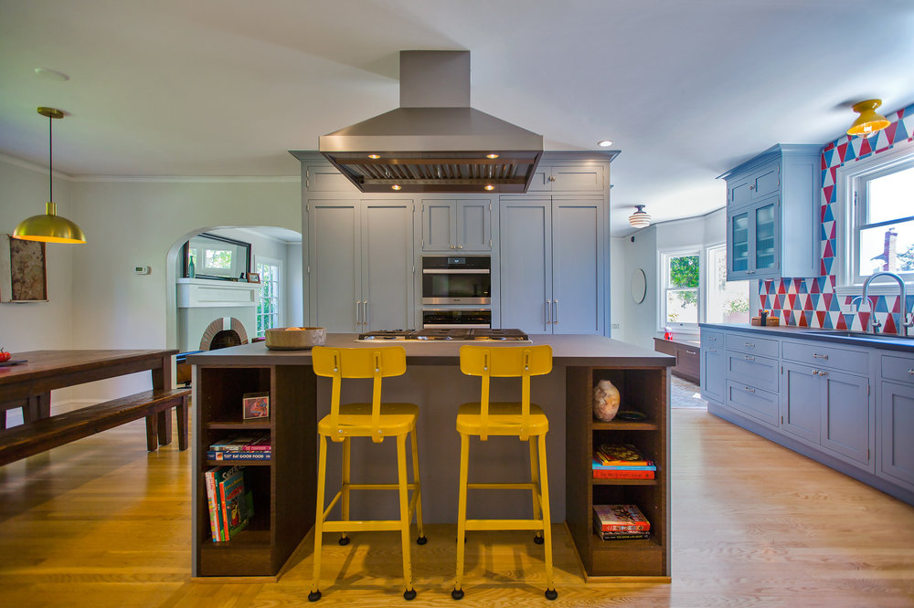 william-adams-design-colorful-tudor-kitchen-island-yellow-chairs.jpg