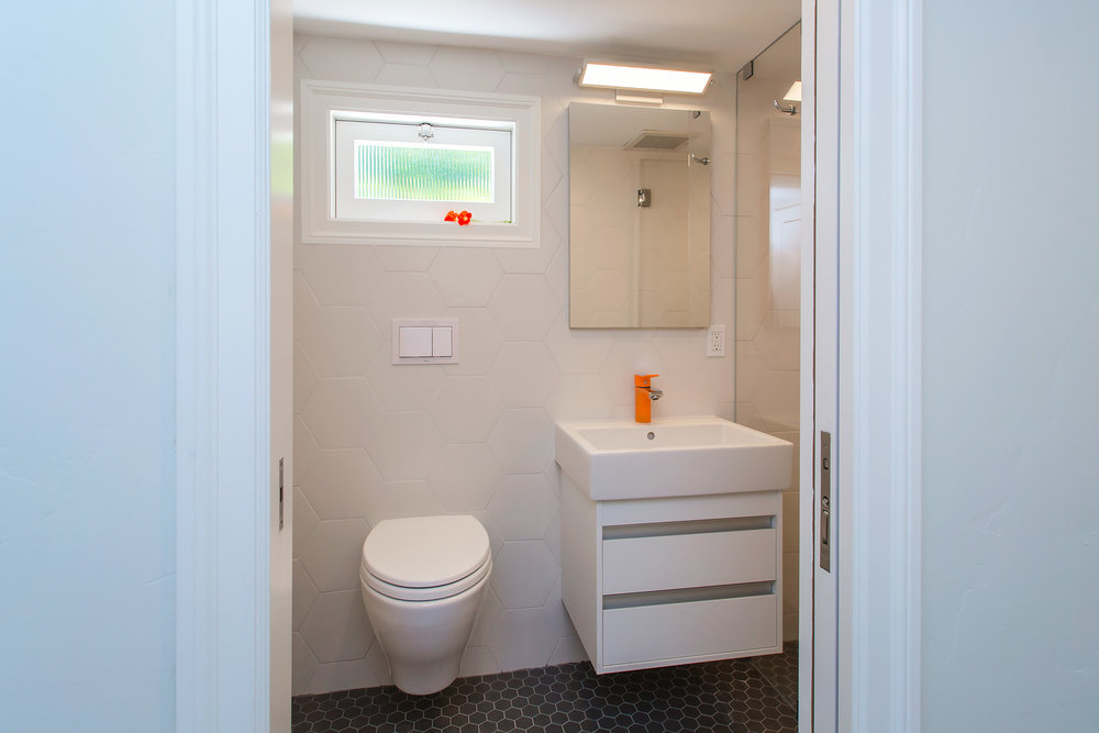william-adams-design-colorful-tudor-second-bathroom-entrance.jpg