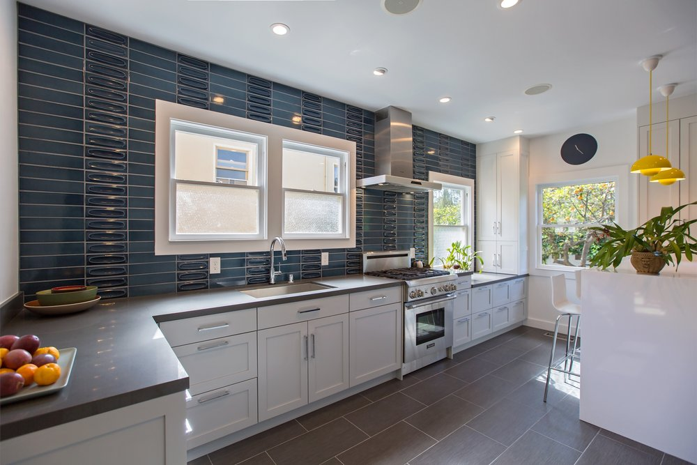 william-adams-design-christmas-tree-lane-2-kitchen-white-cabinets-grey-floors-blue-tile-backsplash.jpg