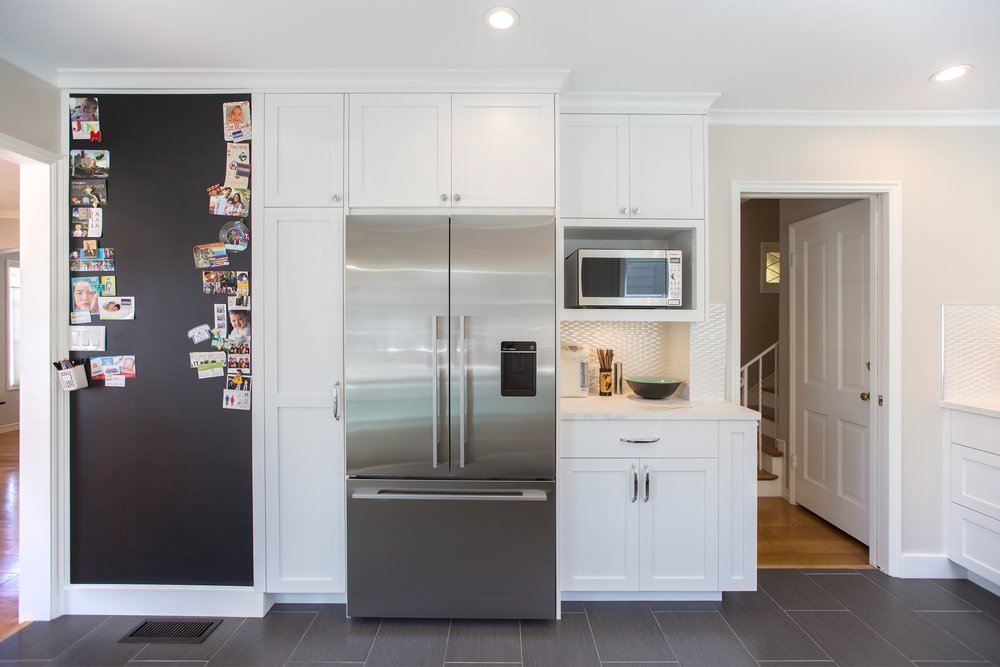 william-adams-design-clement-kitchen-white-cabinets-grey-tile-floors-stainless-steel-refrigerator.jpg