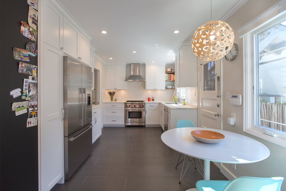 william-adams-design-clement-kitchen-white-cabinets-grey-tile-floors-white-backsplash-breakfast-area.jpg