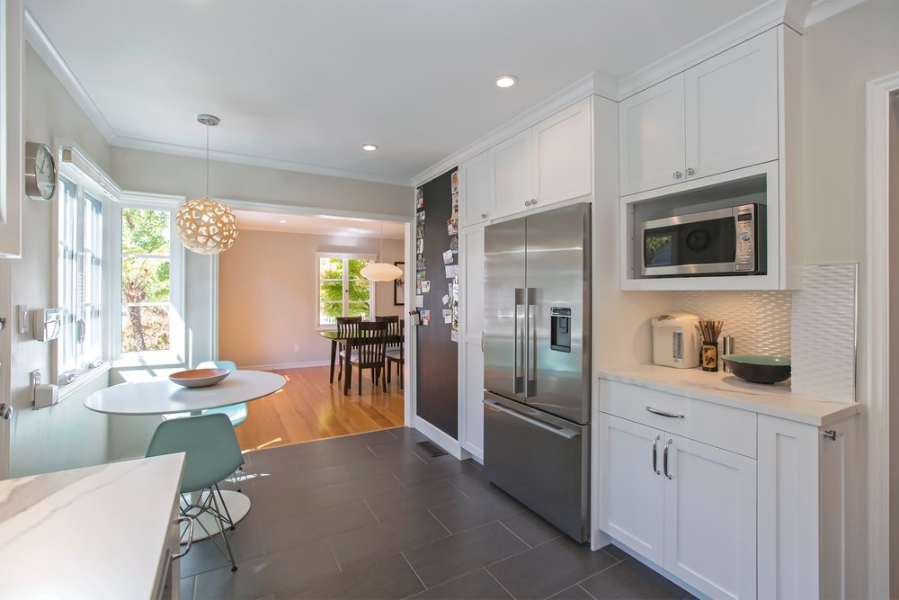 william-adams-design-clement-kitchen-white-cabinets-grey-tile-floors-wide-view-to-dining-area.jpg