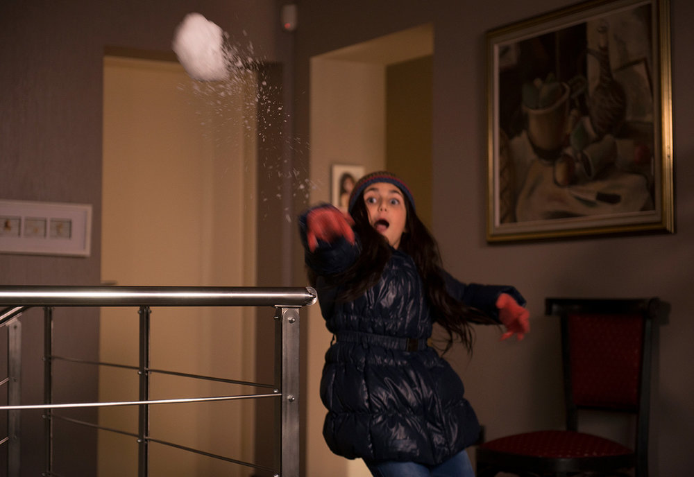 Ruby Strangelove having a snowball fight inside her home