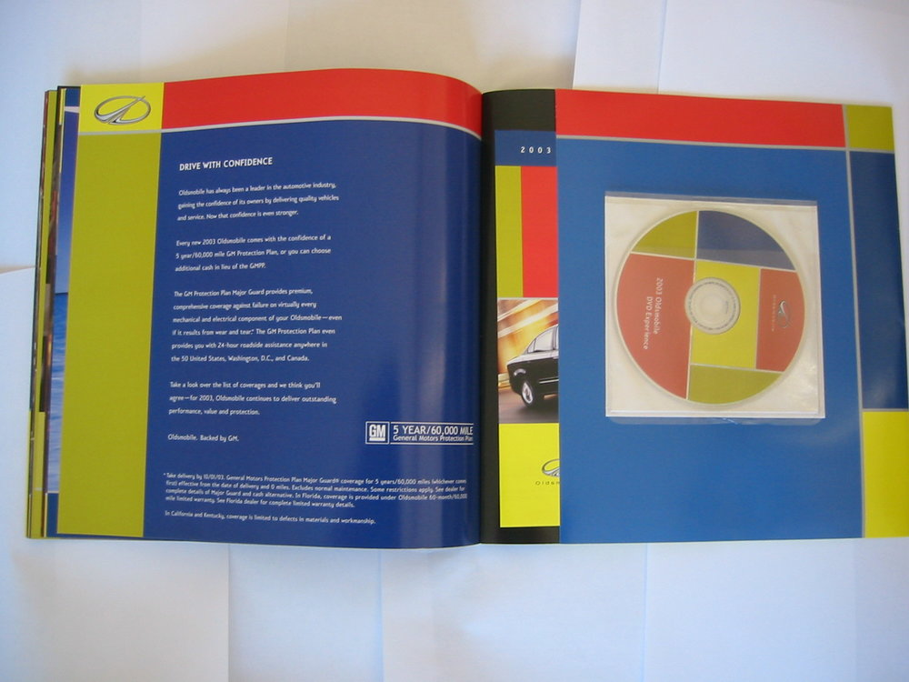 Oldsmobile Auto Catalog & DVD Experience - Inside Back Cover with DVD & Model Spec Inserts