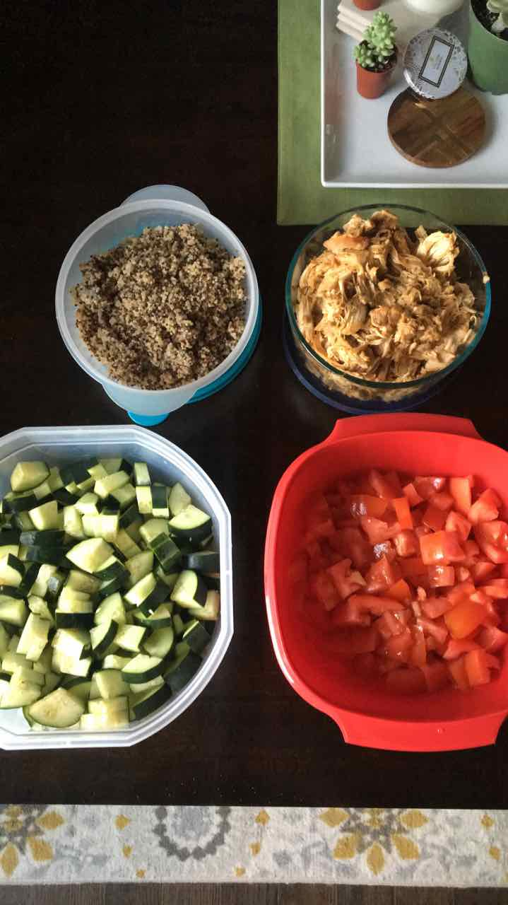 Cooked quinoa, slow cooked chicken, and veggies for salad.