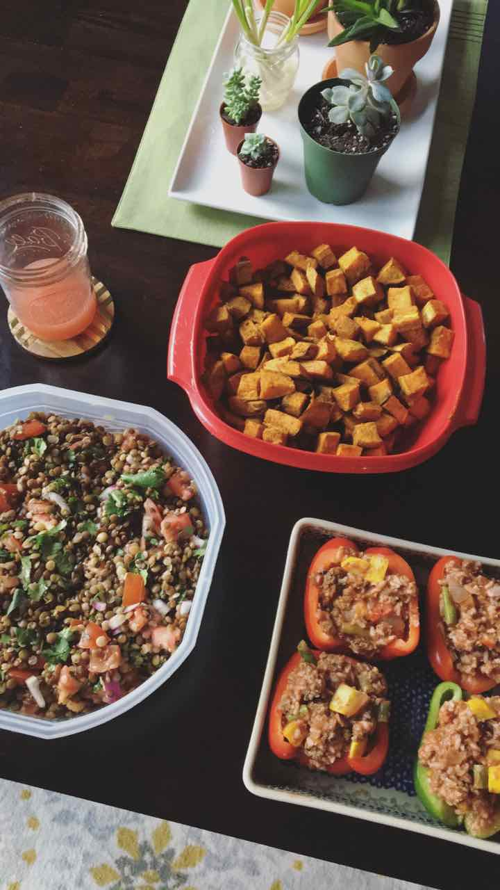 Spicy lentil salad, roasted sweet potatoes, and stuffed peppers.