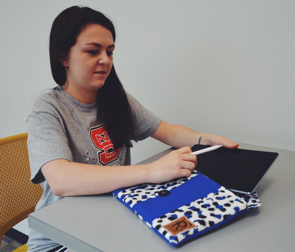 Peyton using her new iPad sleeve.