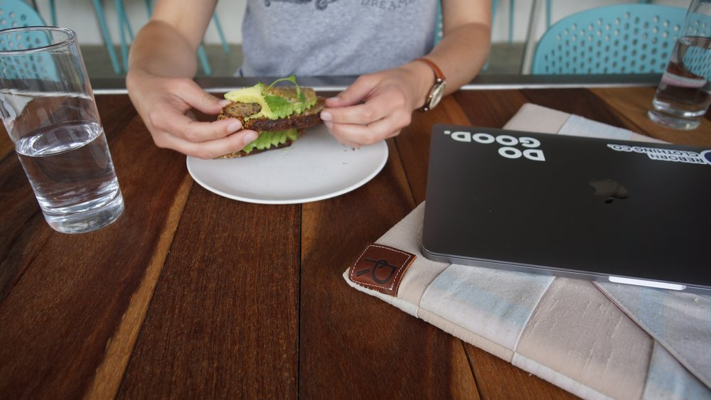 Enjoying avocado toast and a sustainably-made Reborn laptop sleeve at Hummingbird in Raleigh, NC.