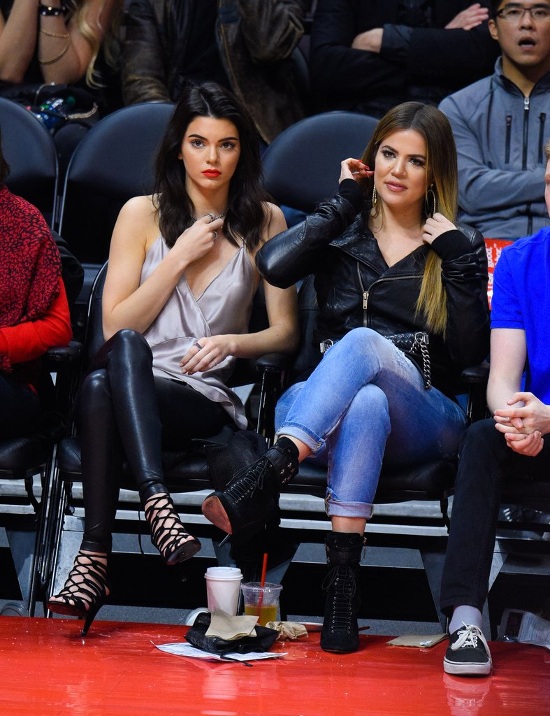 Opting for a sultry look, Kendall wore a silk tank and black lace up heels to the LA Clippers game in 2015.
