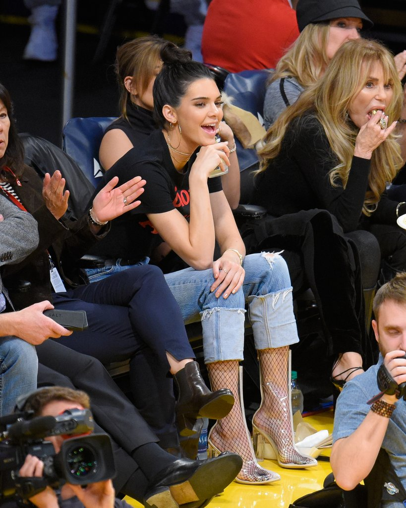 The rise of the fishnets! Kendall Jenner showed off her tights in PVC boots at an LA Lakers game in 2017.