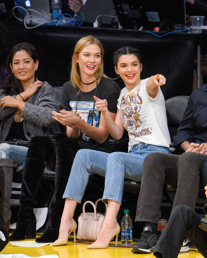 Both Karlie Kloss and Kendall Jenner wore vintage graphic t-shirts to the LA Lakers game in 2016.