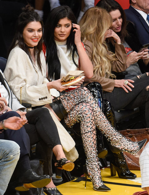 Once again opting for thigh-highs, Kendall rocked patterned lace-up Sophia Webster bots, an Opening Ceremony's oversized linen suit jacket, a black choker, and a bright red lip.