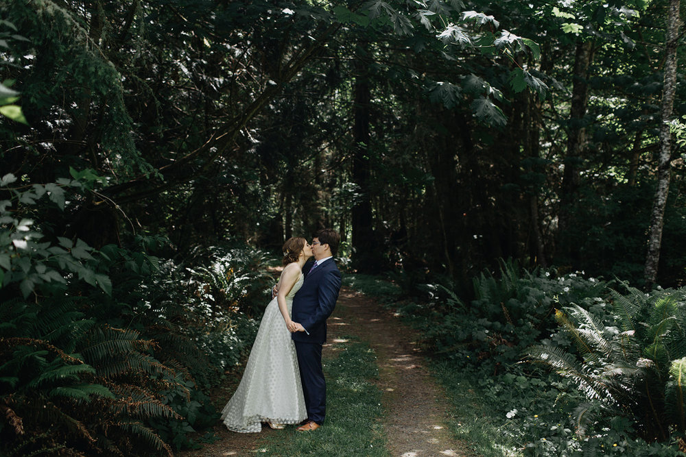 photo-of-bride-and-groom-kissing-in-the-forest