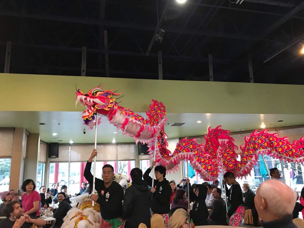 White Lotus Dragon & Lion dance performing dragon dance at HK Cafe restaurant