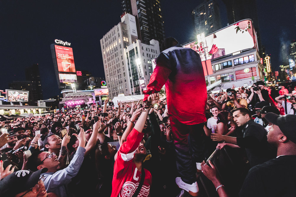 Jazz Cartier was just one of the amazing acts that played NXNE's Yonge Street Festival Village in 2018. Look for more amazing acts in 2019. (photo by Ashton Mills, Jazz Cartier guitarist and Kaylee Smoke).