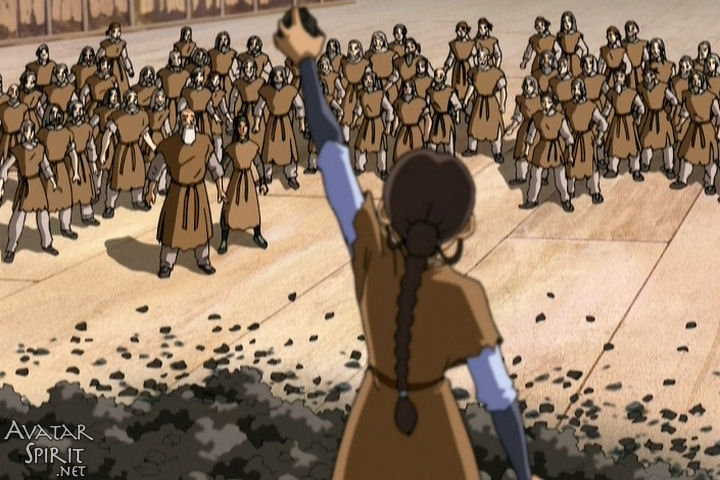 Katara holds up a piece of coal as she makes an inspiring speech to the imprisoned earthbenders. Sheesh, even in fictional universes women have to do all the work.