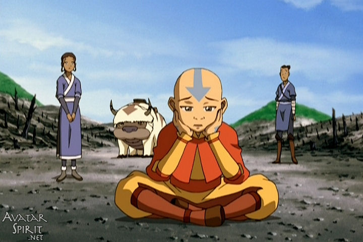 Aang looks sadly at the burned remnants of Hei Bai's forest while the rest of the Gaang watches. No funny caption here. Lil Baby Aang is finally growing up. Sort of.