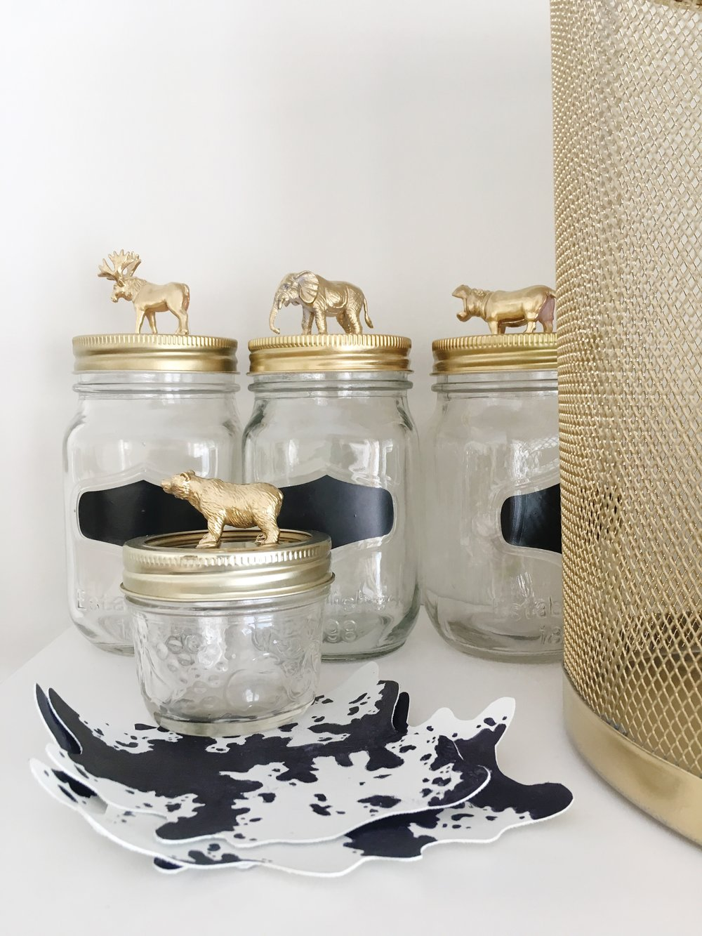 "DIY DECORATED JARS                96                Normal     0                     false     false     false         EN-US     X-NONE     X-NONE                                                                                                                                                                                                                                                                                                                                                                                                                                                                                                                                                                                                                                                                                                                                                                                                                                                                                                                                                                                                                                                                                                                                                                                                                                                                                                                                                                                                                                                                                                                                                                                                                                                                                                                                 /* Style Definitions */ table.MsoNormalTable 	{mso-style-name:""Table Normal""; 	mso-tstyle-rowband-size:0; 	mso-tstyle-colband-size:0; 	mso-style-noshow:yes; 	mso-style-priority:99; 	mso-style-parent:""""; 	mso-padding-alt:0cm 5.4pt 0cm 5.4pt; 	mso-para-margin:0cm; 	mso-para-margin-bottom:.0001pt; 	mso-pagination:widow-orphan; 	font-size:12.0pt; 	font-family:Calibri; 	mso-ascii-font-family:Calibri; 	mso-ascii-theme-font:minor-latin; 	mso-hansi-font-family:Calibri; 	mso-hansi-theme-font:minor-latin;}      Materials:  - Mason Jars, any size - Drop Cloth - Strong Glue (Super or Hot Glue) - Figurines - Spray Paint  Steps:  1. Remove lid (including rim) from mason jar. 2. Select the figurine you'd like to place on the top of each jar. Using the glue, attach each figurine to the centre of the jar lid. Allow to dry. 3. Place the lid (with figurine now attached) on a drop cloth to paint. Use the spray paint to apply the first layer, making sure to cover all angles of the figurine. Allow to dry before applying second and third layer. 4. Once fully dried you can now place the lid back on the jar and use it for storing smaller items!                96                Normal     0                     false     false     false         EN-US     X-NONE     X-NONE                                                                                                                                                                                                                                                                                                                                                                                                                                                                                                                                                                                                                                                                                                                                                                                                                                                                                                                                                                                                                                                                                                                                                                                                                                                                                                                                                                                                                                                                                                                                                                                                                                                                                                                                 /* Style Definitions */ table.MsoNormalTable 	{mso-style-name:""Table Normal""; 	mso-tstyle-rowband-size:0; 	mso-tstyle-colband-size:0; 	mso-style-noshow:yes; 	mso-style-priority:99; 	mso-style-parent:""""; 	mso-padding-alt:0cm 5.4pt 0cm 5.4pt; 	mso-para-margin:0cm; 	mso-para-margin-bottom:.0001pt; 	mso-pagination:widow-orphan; 	font-size:12.0pt; 	font-family:Calibri; 	mso-ascii-font-family:Calibri; 	mso-ascii-theme-font:minor-latin; 	mso-hansi-font-family:Calibri; 	mso-hansi-theme-font:minor-latin;}      DIY PAINTED TRASH CAN  Materials:  - Existing metal trash can - Spray Paint - Drop Cloth  Steps:  1. Clean metal trash can 2. Place drop cloth in a well ventilated area. 3. Spray paint trash can and allow to dry before applying 2nd or 3rd coat."