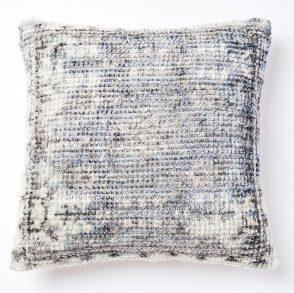 As a designer, you'd think that I would love patterns. Truth be told, I am not a fan! I'd rather focus on layering textures and colours then using bold and solid patterns.  This pillow  is the right amount of texture and pattern. The distressed feel to the pillow blurs the lines of a solid pattern, which is A-okay in my books!